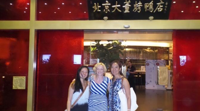 Being taken to a tasty duck restaurant in Beijing